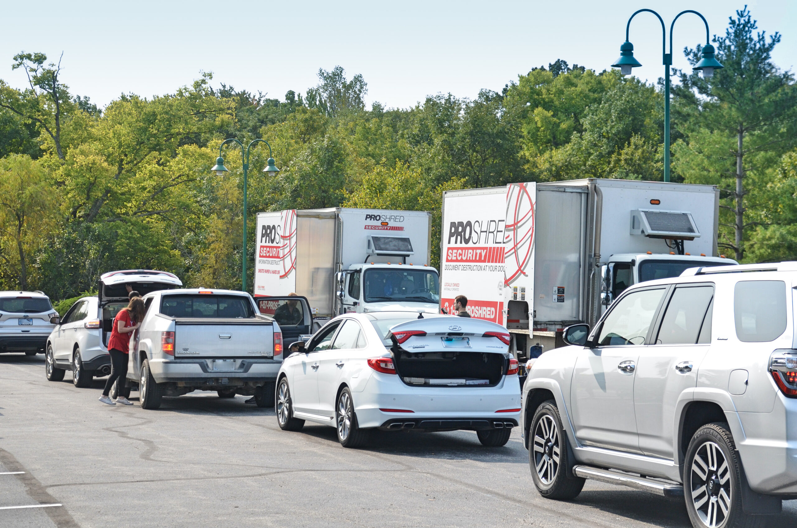 Cars in line at 2019 Shred Day in Leawood Office parking lot.