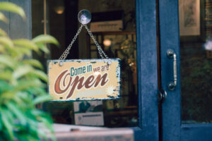 Open sign hanging on shop door