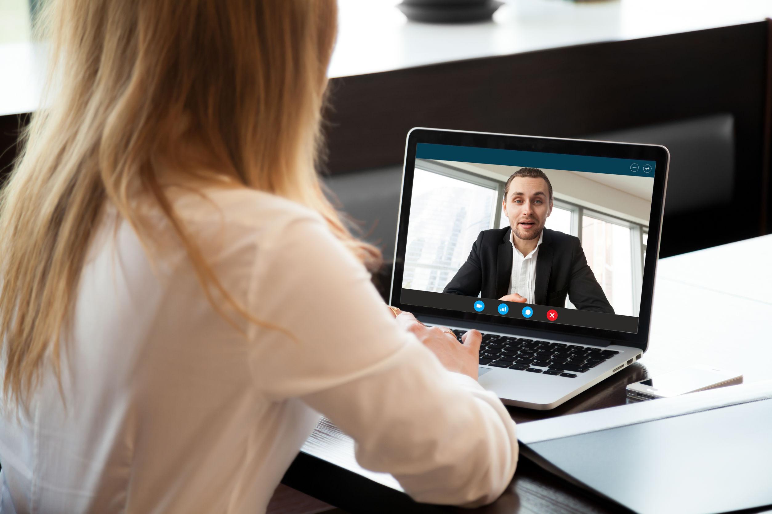 Woman at desk in virtual meeting
