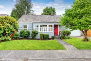 Image description: Exterior of small suburban house with blue paint