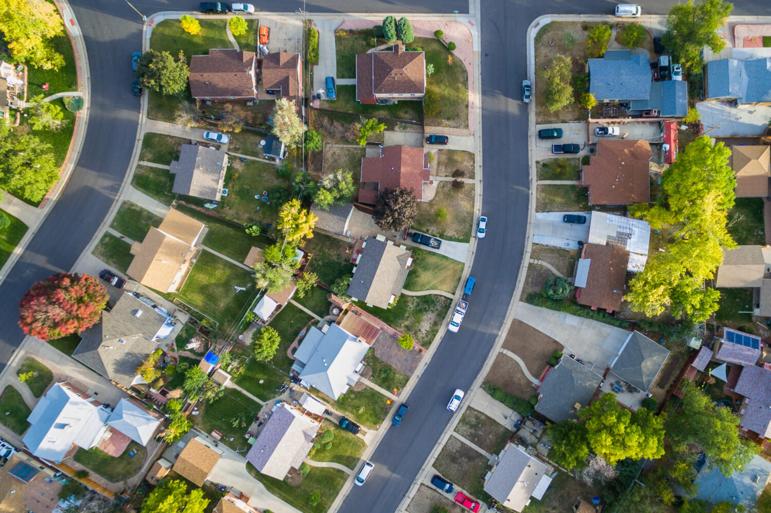 Image description: Aerial view of residential neighborhood in the Autumn.