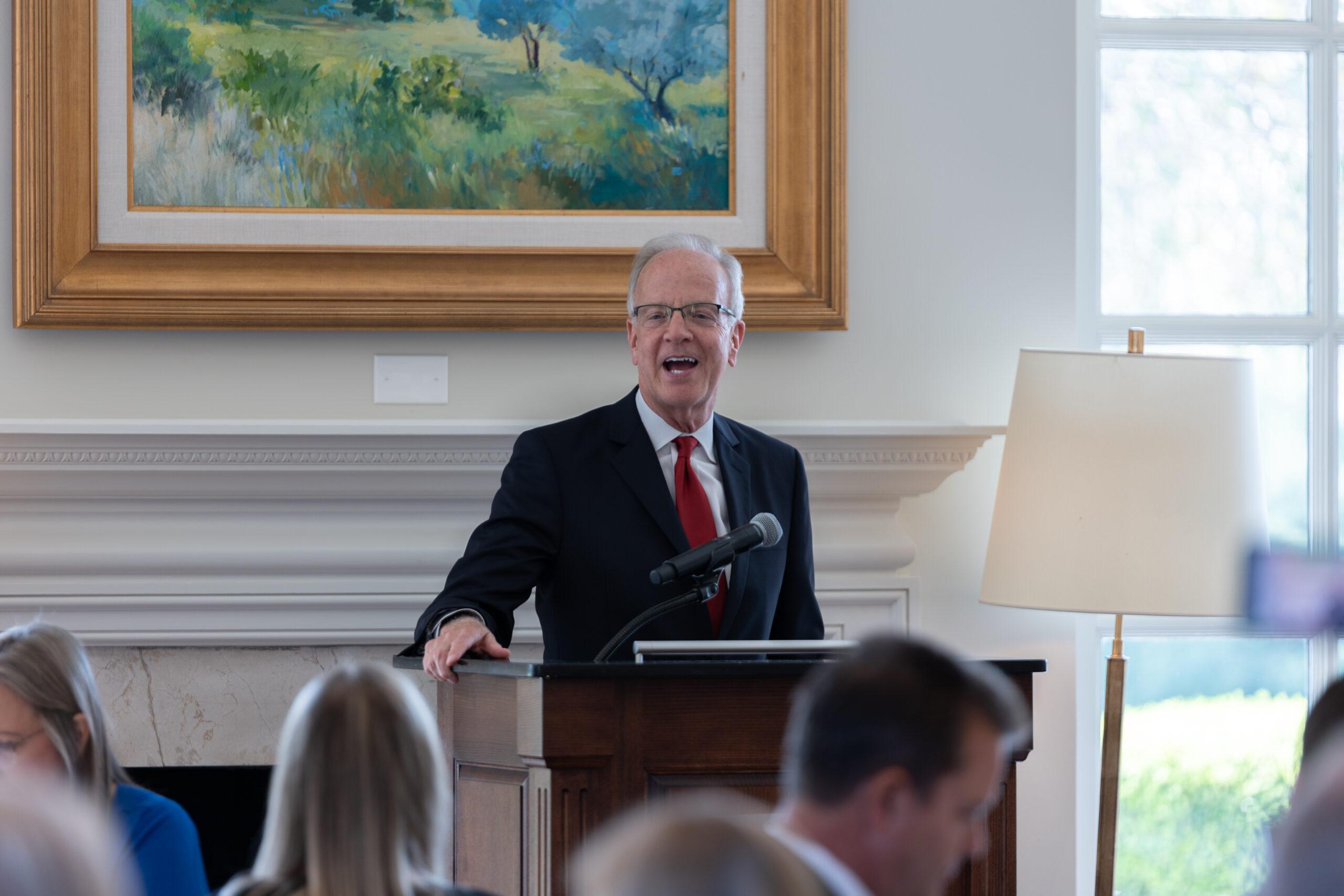Image description: Senator Jerry Moran speaks at a podium to a room of Kansas City REALTORS.