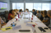 Image description: The KCRAR Forms Committee sits around the table in the newly updated boardroom.